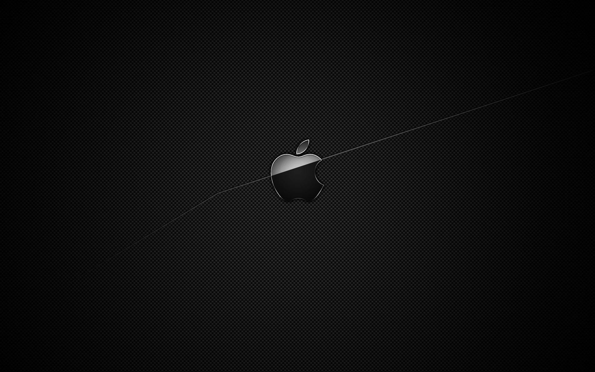 A Black Apple Symbol On Dark Black Background Half Part Lighted Up