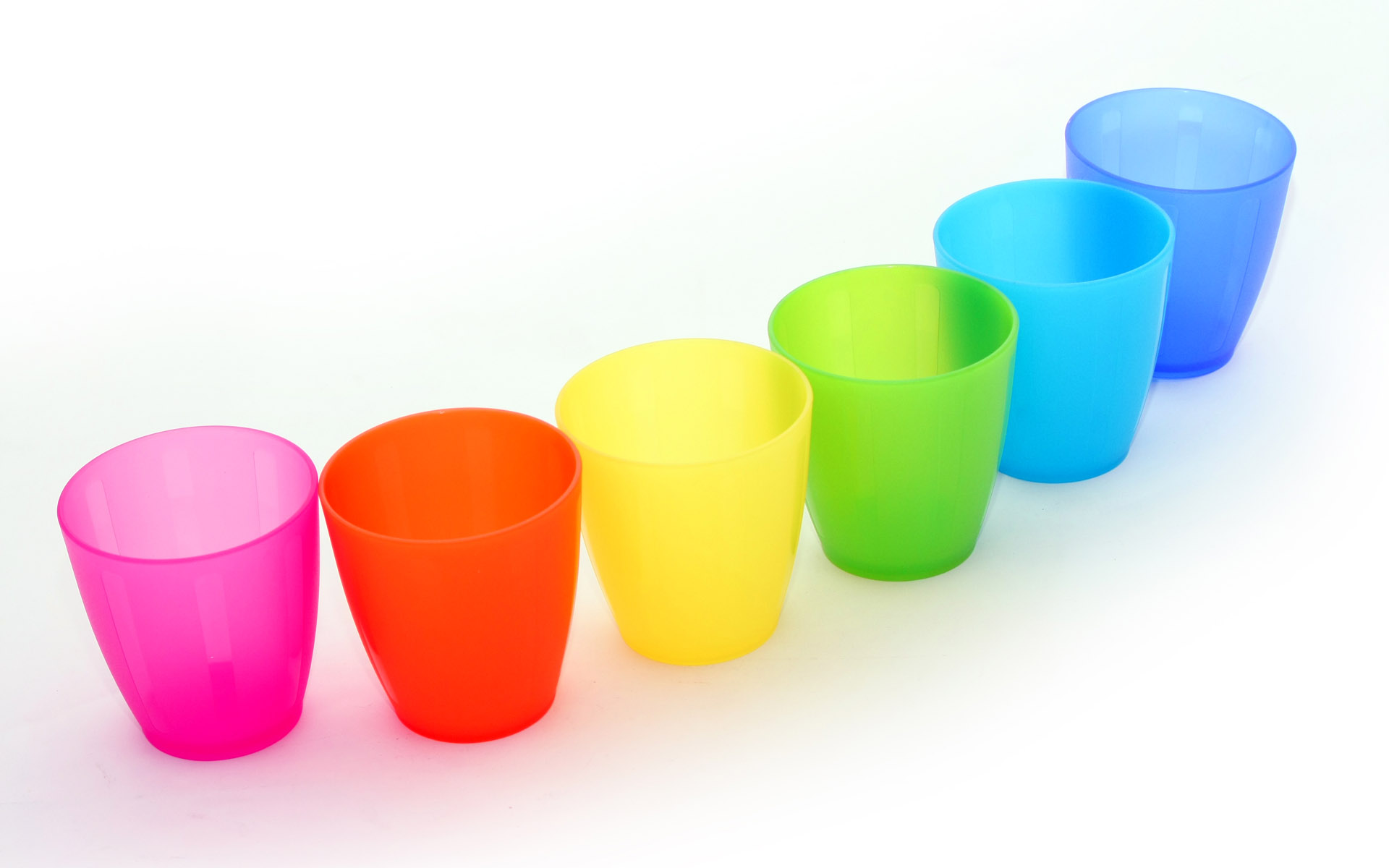 A Line Of Colorful And Beautiful Cups White Background