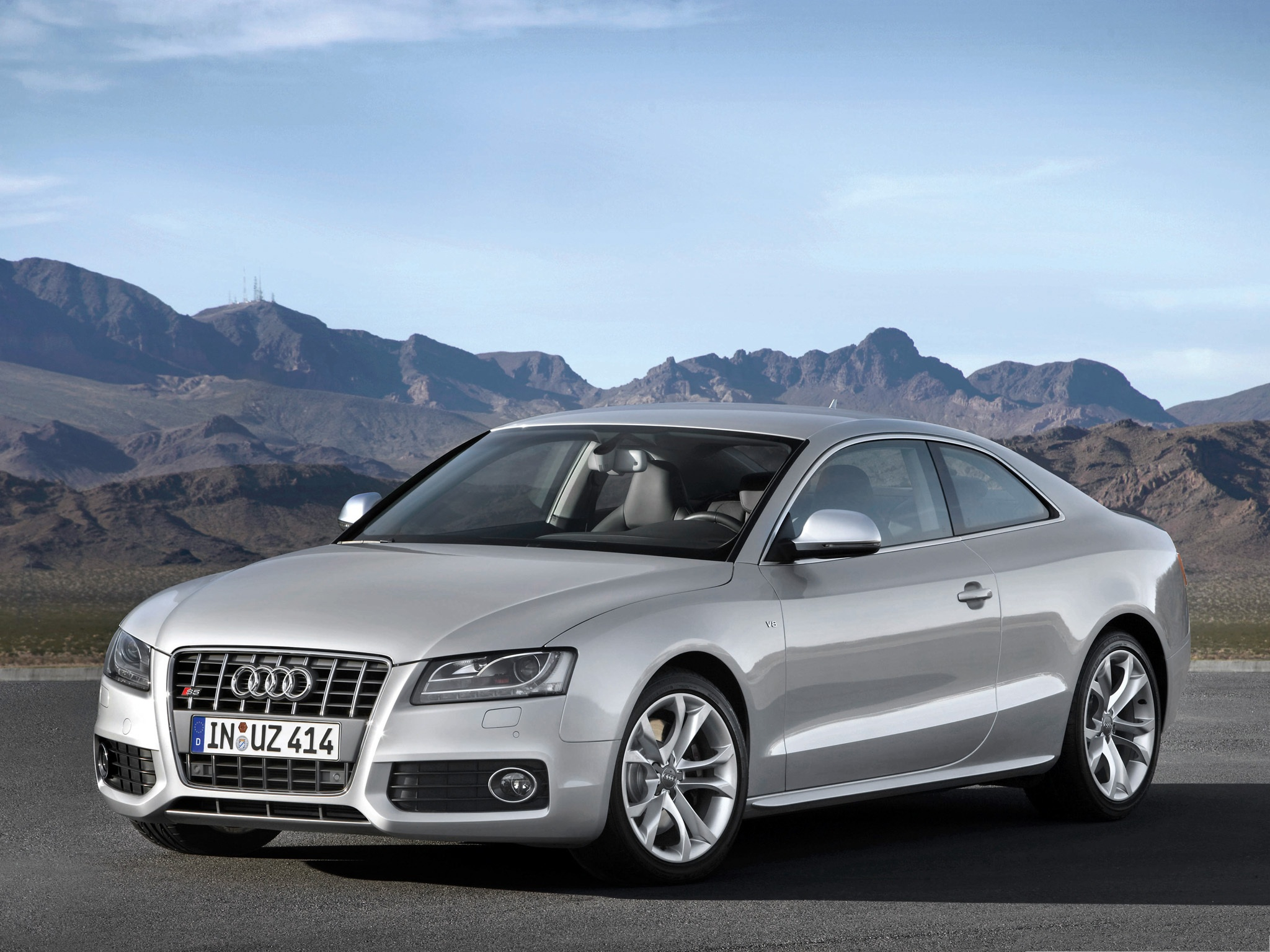 Audi S5 Coupe Car Silver Super Car Among Tall Hills What