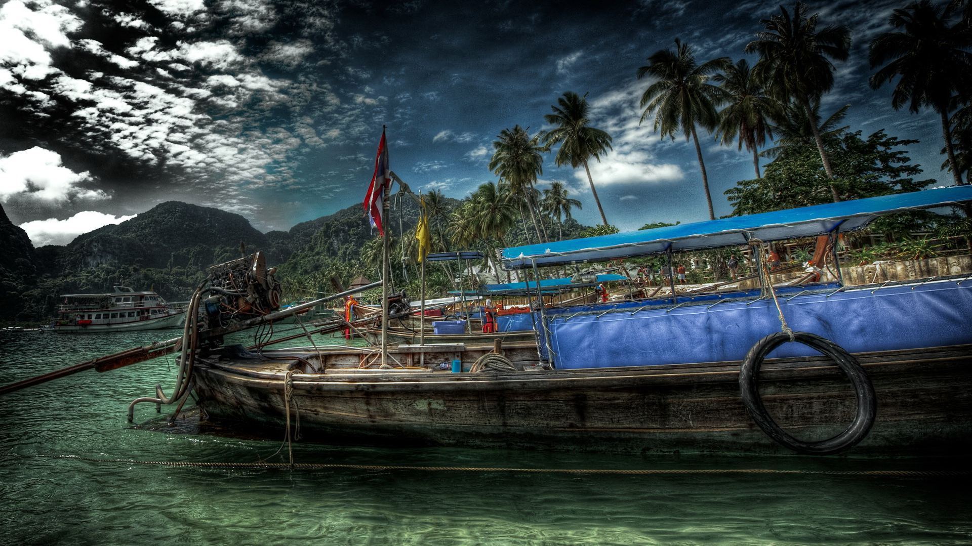click to free download the wallpaper--Beautiful Beach Scene - Coconut Trees All Over the Beach, an Old Boat on the Clear River, the Dark Sky 1920X1080 free wallpaper download