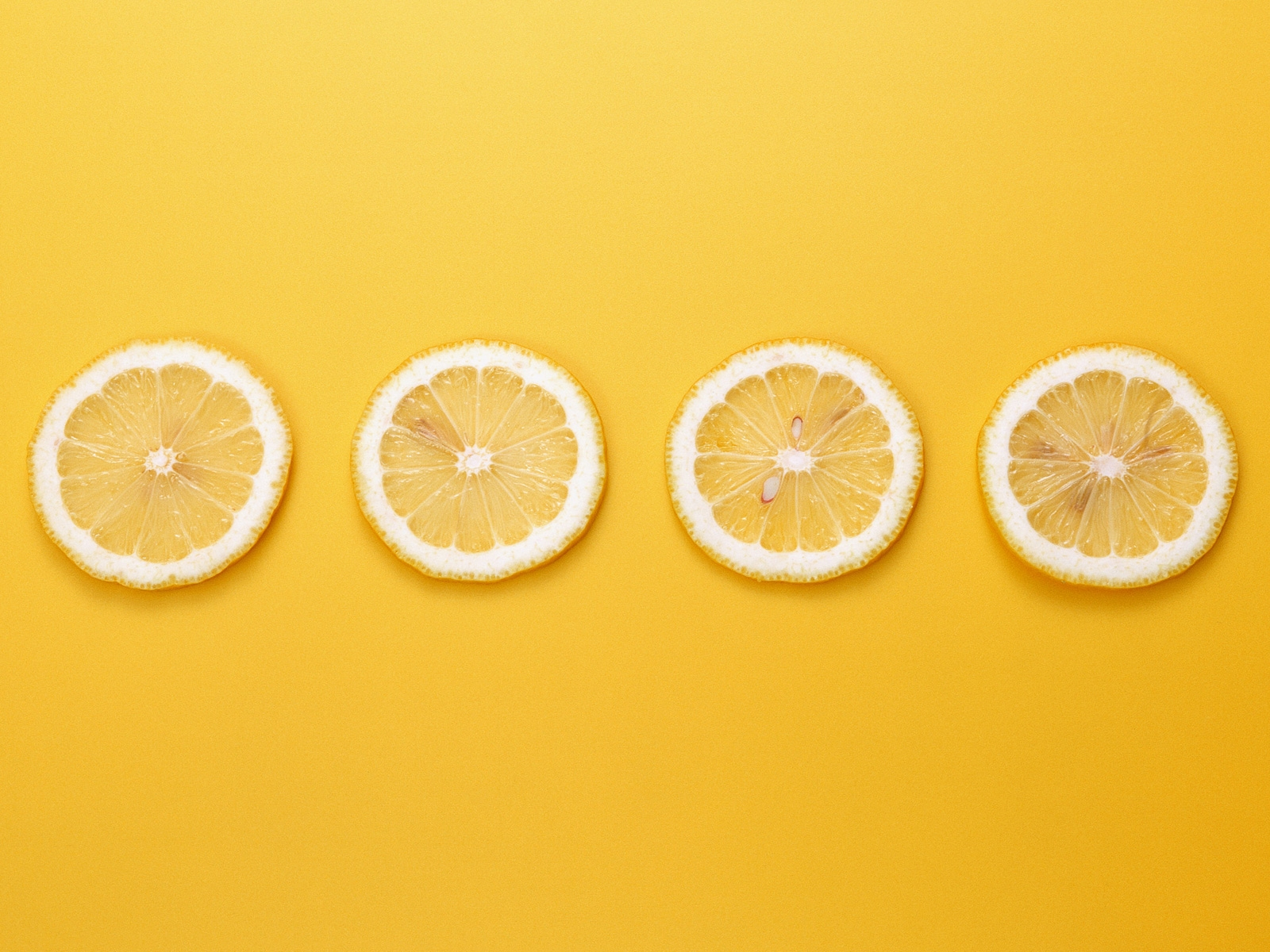 click to free download the wallpaper--Cute Fruits Wallpaper, 4 Lemons in a Line, Yellow Background, Incredible Scene