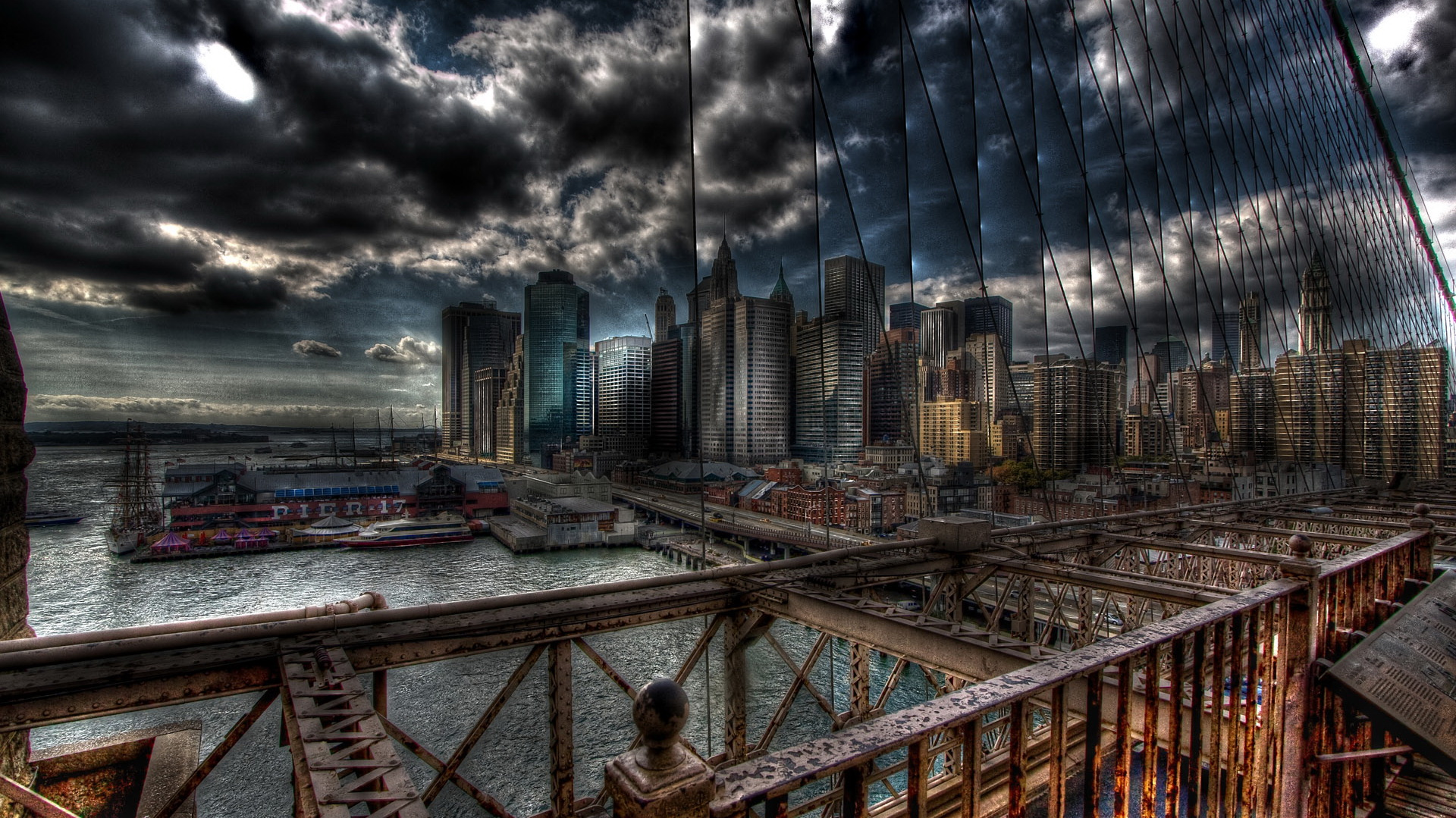 click to free download the wallpaper--Depressing City Scenes - Tall Buildings Added with Gloomy Atmosphere, the Dark and Cloudy Sky, a Large Bridge 1920X1080 free wallpaper download