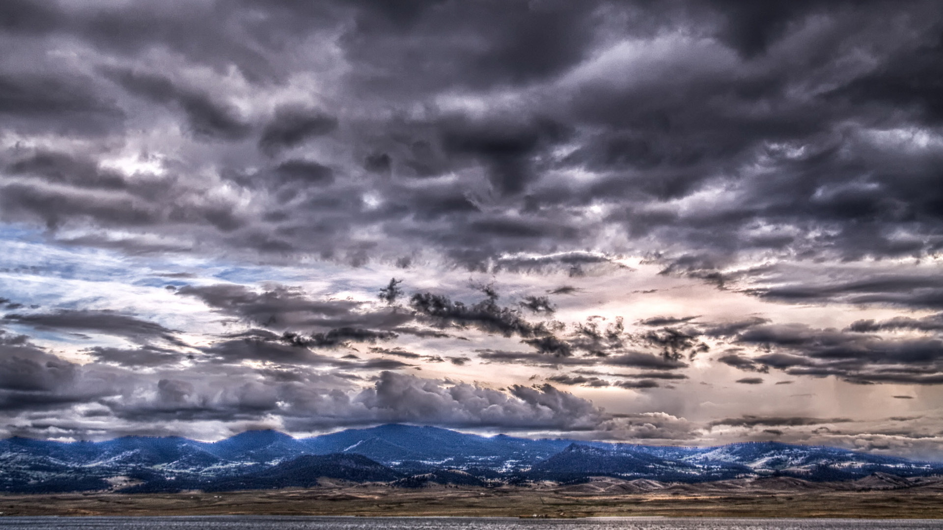 click to free download the wallpaper--Depressing Scene of Nature - The Sky is Dark with Thick Clouds, Mountains Are Tall As to Reach the Sky 1920X1080 free wallpaper download