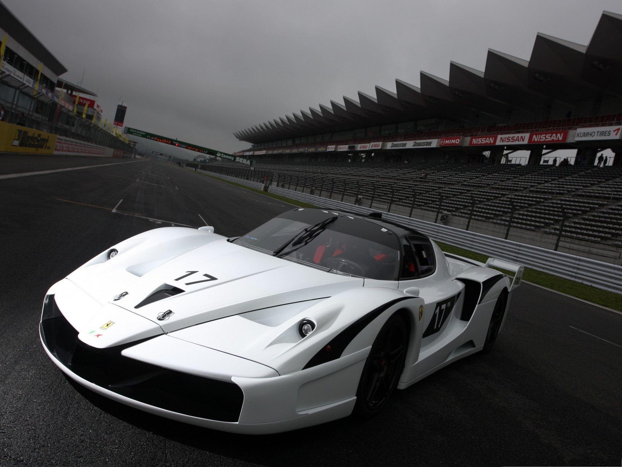 click to free download the wallpaper--Ferrari Racing Car, White Decent Car in Race, Get a Good Score 2048X1536 free wallpaper download