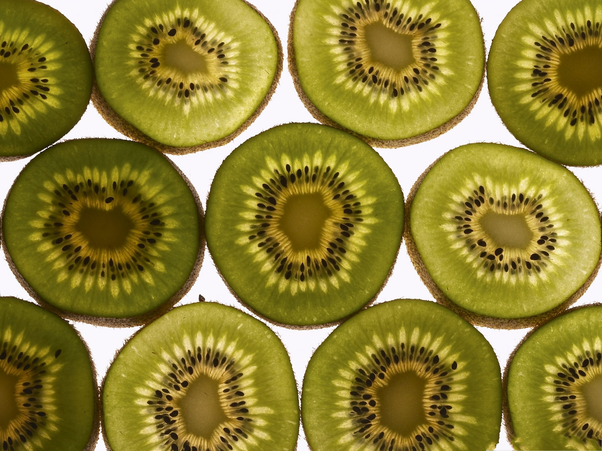 click to free download the wallpaper--Free Fruit Wallpaper, Kiwis Cut into Half, Want a Bite? 2048X1536 free wallpaper download