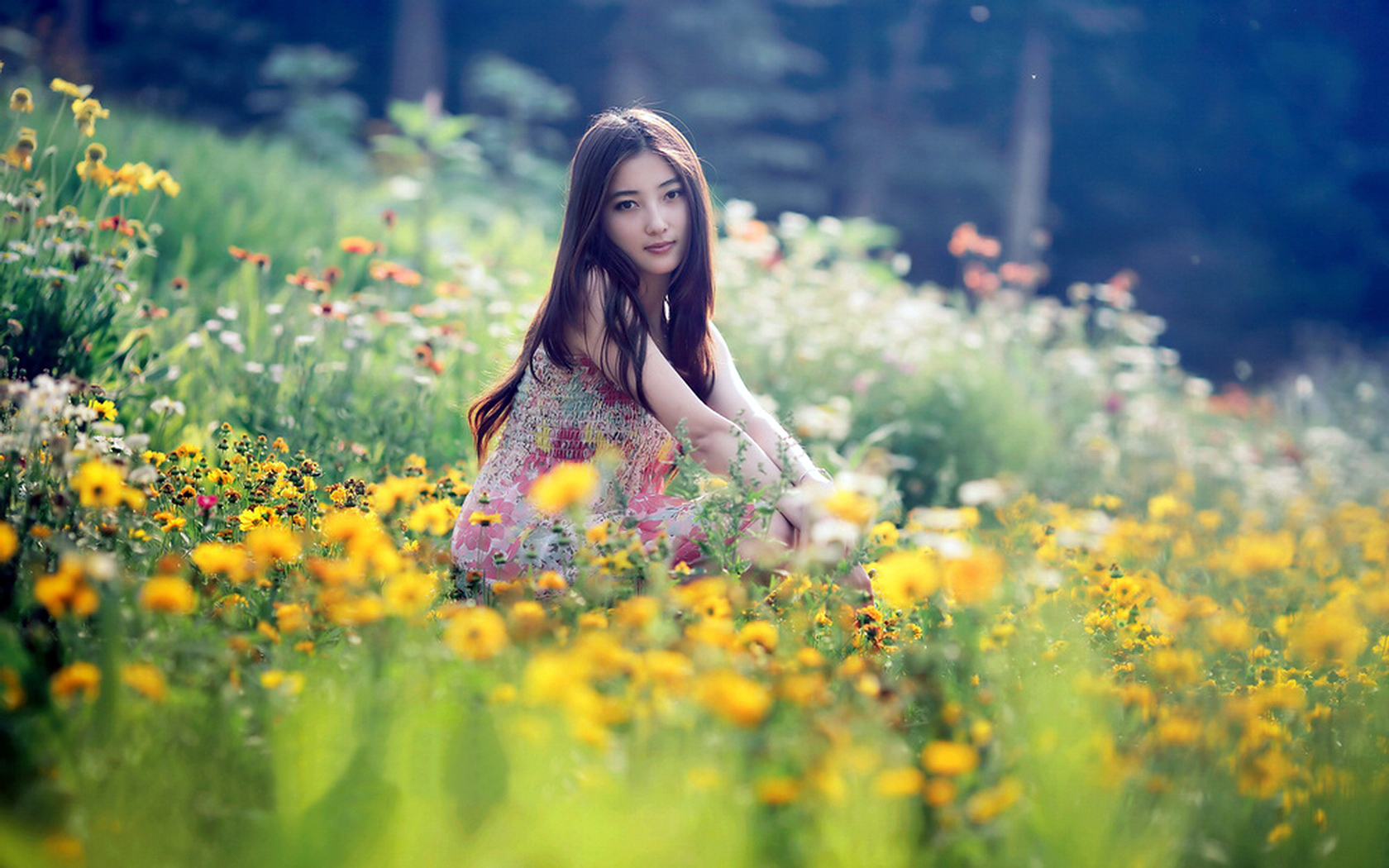 girl in flowery dress sitting among numerous flowers the