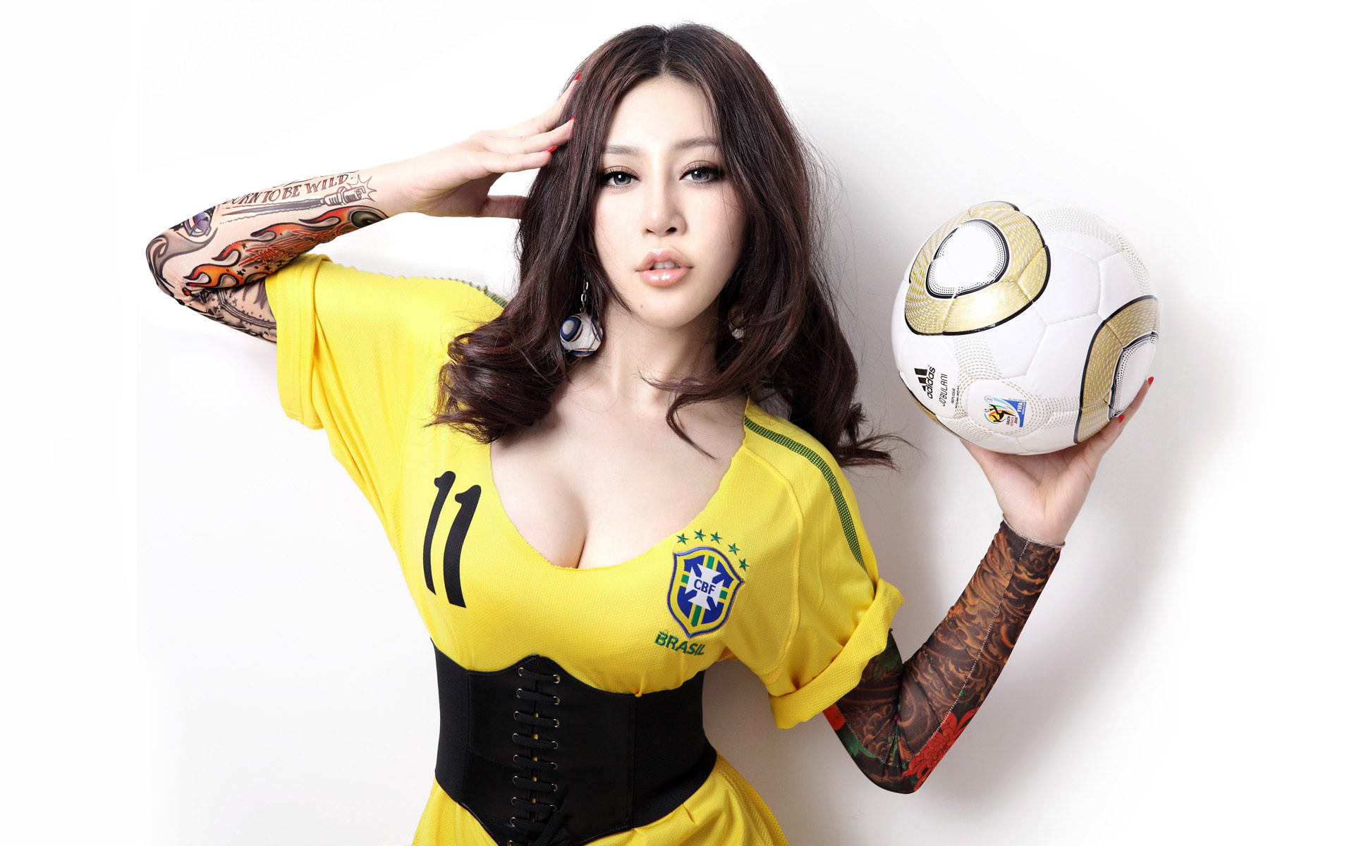Girl In Sports Suit, Holding A Football In The Hand
