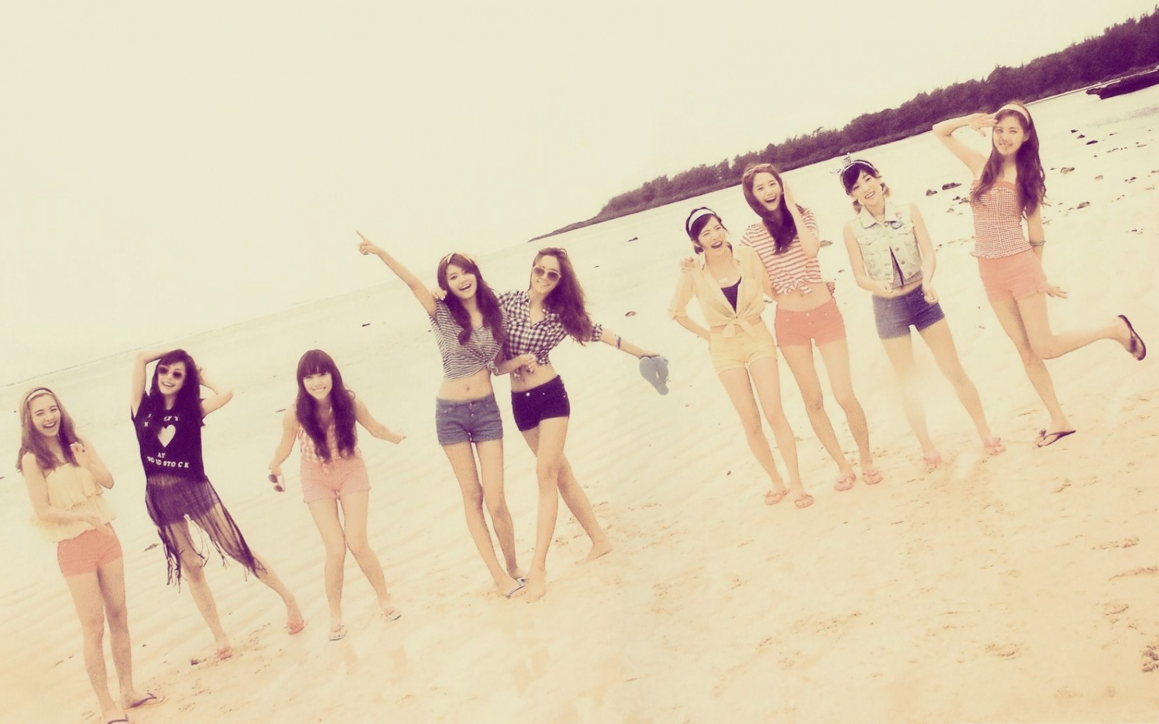 click to free download the wallpaper--Girls Generation Picture, Walking on Beach Sand, Great to be Young 1680X1050 free wallpaper download