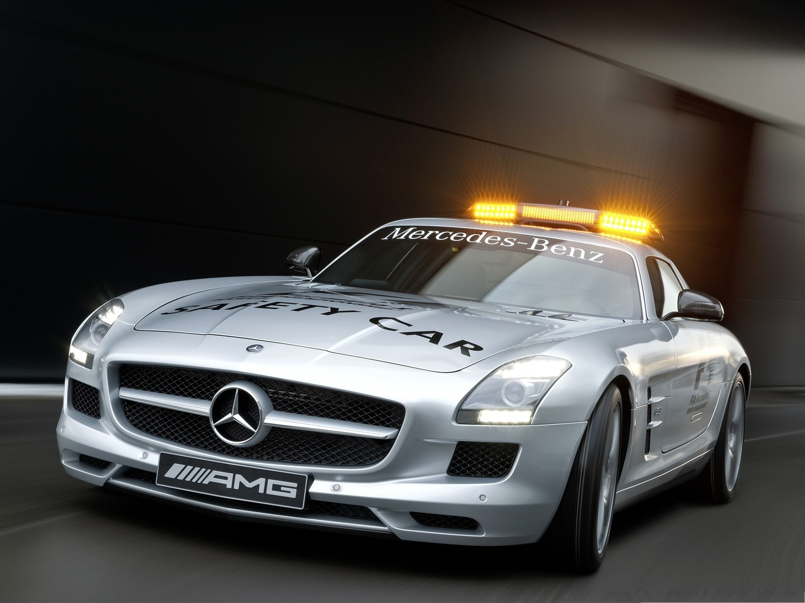 click to free download the wallpaper--Mercedes Benz SLS Wallpaper, Silver Safety Car, Golden Lights Above 1600X1200 free wallpaper download