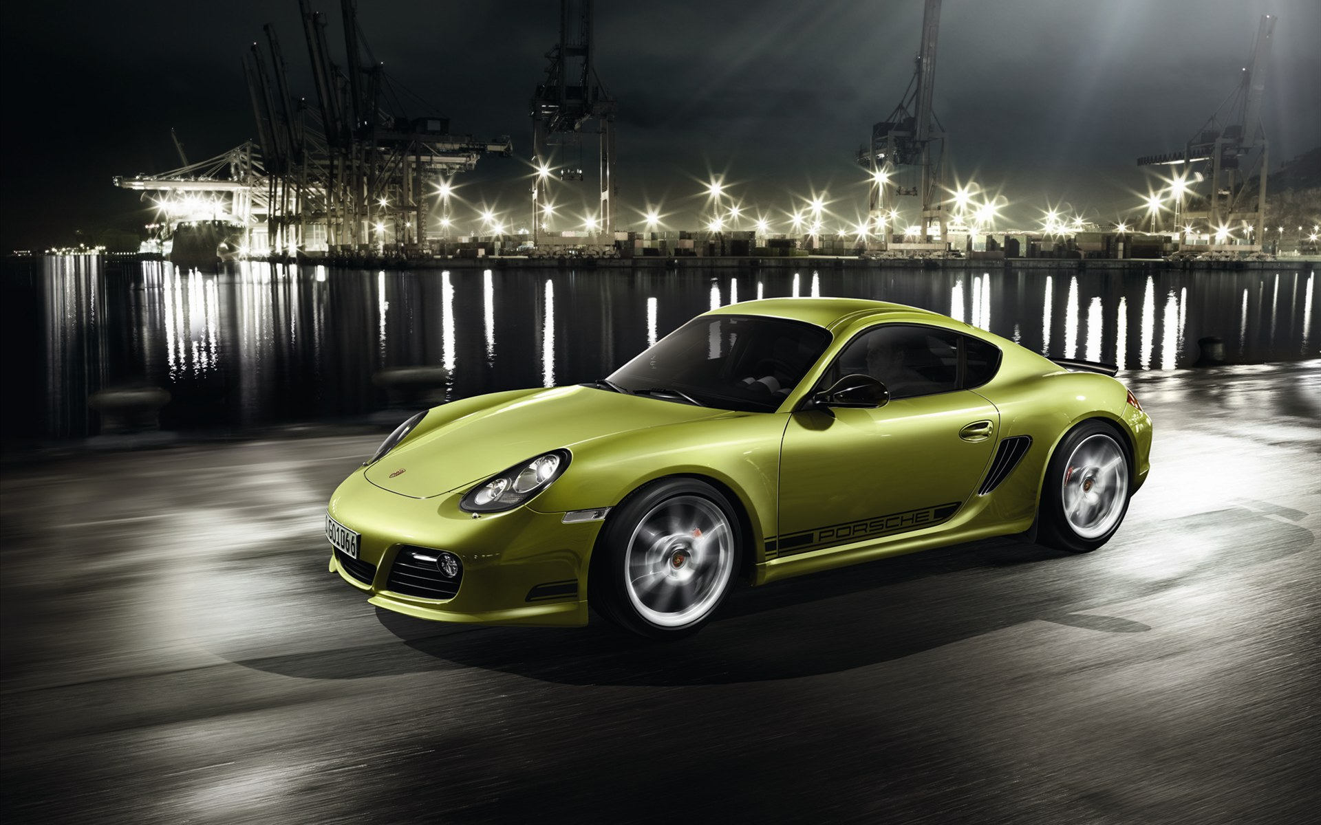 click to free download the wallpaper--Pics of Cars - Porsche Cayman Post in Pixel of 1920x1200, Green Car in Fast Speed, Shinning Lights All Around It 1920X1200 free wallpaper download