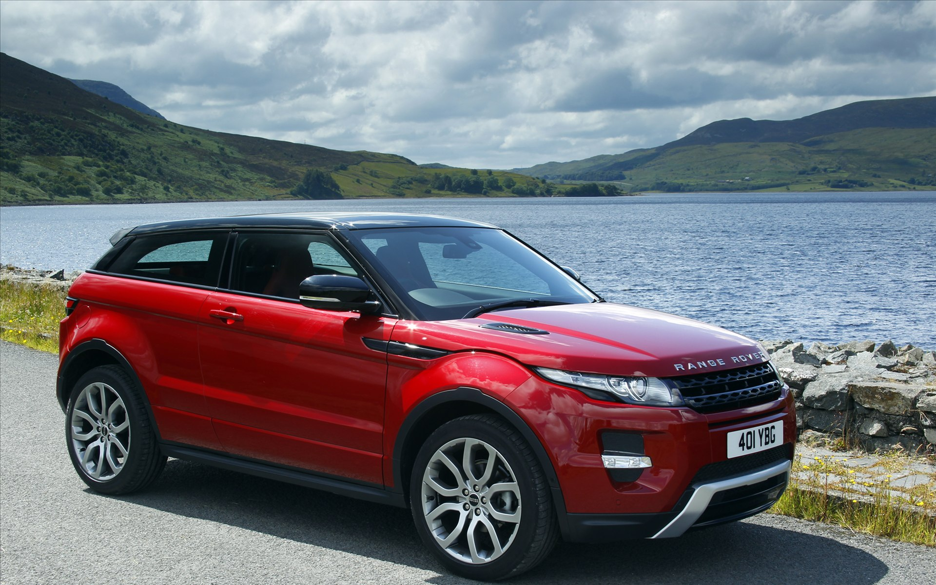 Red Land Rover Car by Seaside, Driving Speed Must be ...