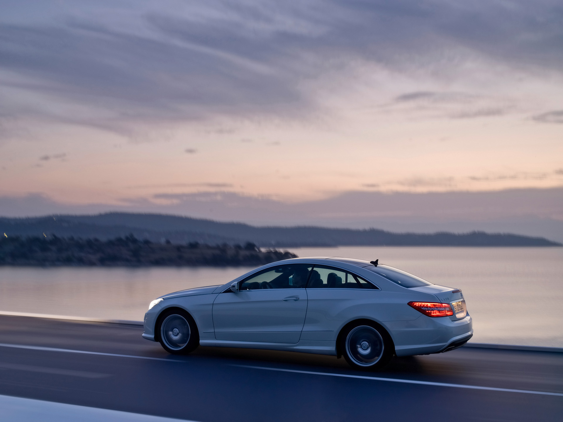click to free download the wallpaper--Top Cars Image, E Coupe on the Road, Driving by the Sea, Be Slow and Enjoy the Scene! 1920X1440 free wallpaper download