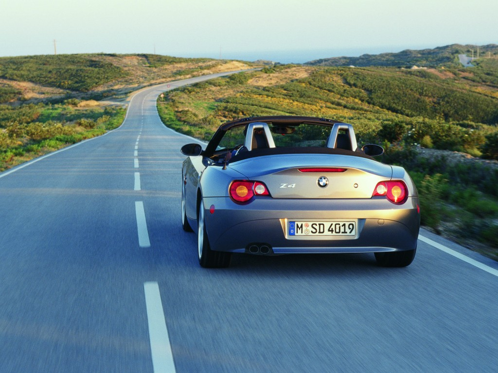Free Wallpaper A Blue Benz Sports Car Running On The Road Free Wallpaper World