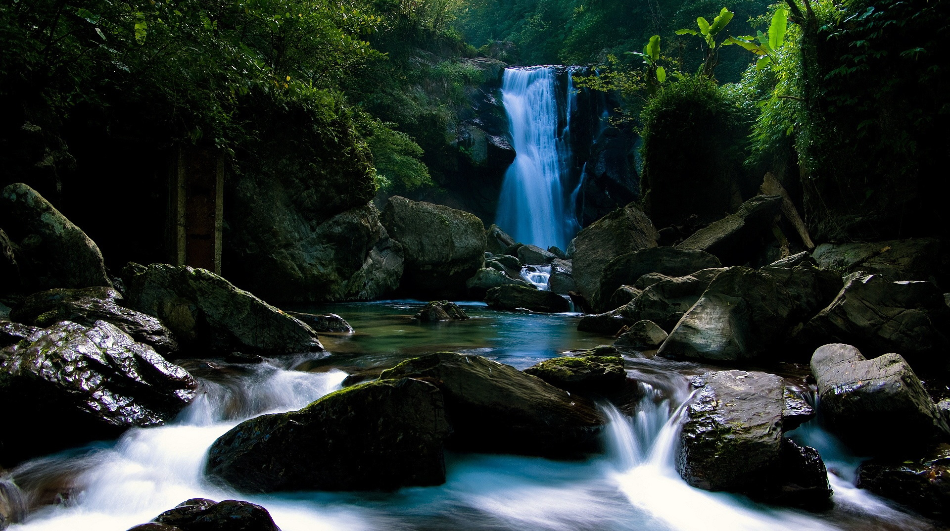 click to free download the wallpaper--photo of nature - The Blue River and a Waterfall, Natural Plants Alongside, an Impressive Scene 1920X1080 free wallpaper download