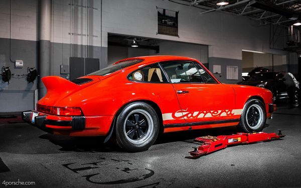 click to free download the wallpaper--1973 Porsche Carrera, Red Super Car in the Stop, Kept Indoor