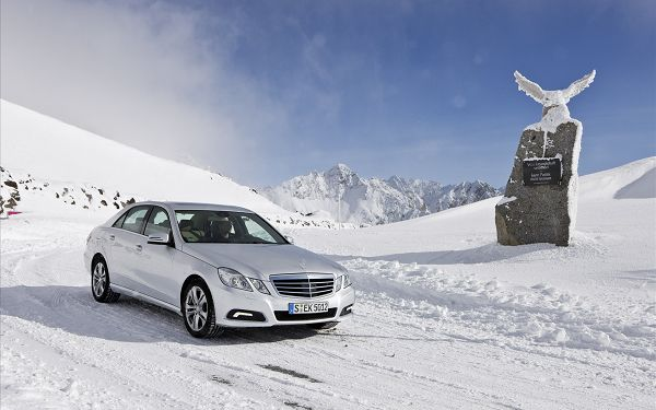 click to free download the wallpaper--2010 Mercedes Benz E Class Post in Pixel of 1920x1200, a Decent and Luxurious Car Standing in the Snowy World, It is Attractive Enough - HD Cars Wallpaper