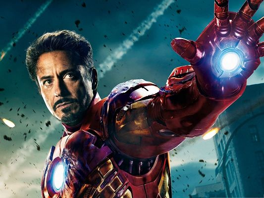click to free download the wallpaper--2013 3D Best Movies, Iron Man 3, Small Flying Pieces Around Him