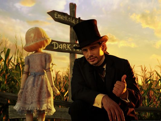 click to free download the wallpaper--3D Movie Posters, Oz The Great and Powerful, Is the Man Asking the Girl for Direction?