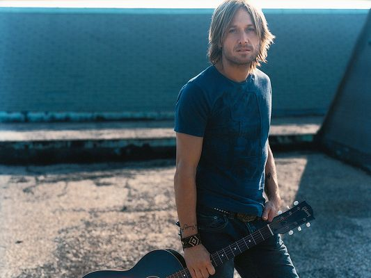 click to free download the wallpaper--A Popular Recording Artist, Seen with Guitar and Depressing Outlook, Producing Wonderful and Pleasing Songs - HD Keith Urban Wallpaper