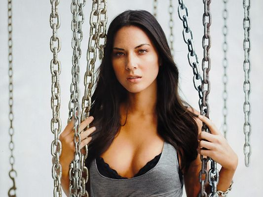 click to free download the wallpaper--A Super Model Perfect in Body Figure, Trapped by Irons Still in Determined Facial Expression, Who Will Help Her out? - HD Olivia Munn Wallpaper