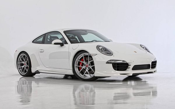 A White Porsche Car in Stop, Direction of Wheels is Changing, Won't Soon Take the Moving Step - Porsche Car Wallpaper