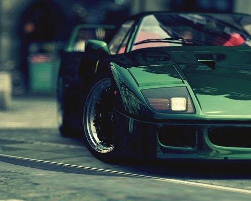 click to free download the wallpaper--Amazing Cars Image, Green Ferrari Turning a Corner, Shinning Look