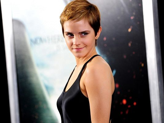 click to free download the wallpaper--Amazing Pic of TV Show, Emma Watson in Short Hair and Smile, Tight Black Vest