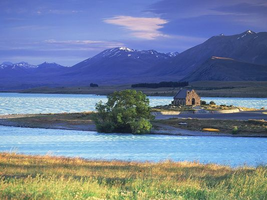 click to free download the wallpaper--Amazing Pics of Nature Landscape, Lake Tekapo, the Blue and Peaceful Sea, High Mountains Alongside