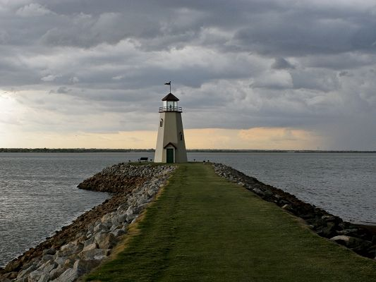 click to free download the wallpaper--Amazing Pics of Nature Landscape, a Lighthouse by Seaside, Green Grass as Carpet