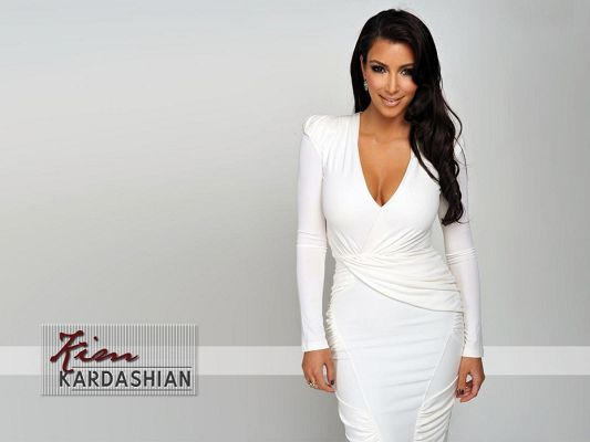click to free download the wallpaper--Amazing TV Shows Photo, Kim Kardashian in White Dress, Beautiful in Smile