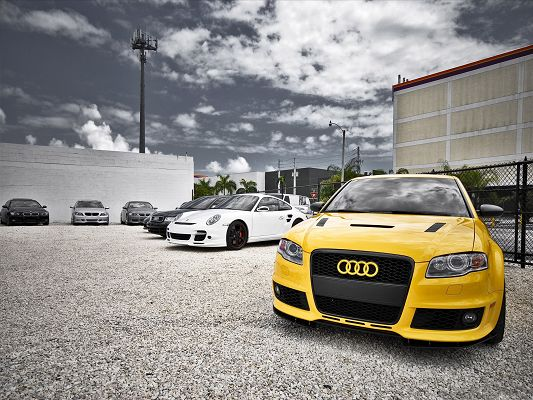 click to free download the wallpaper--Audi Car Wallpaper, Yellow Super Car in the Stop, Under the Blue Sky