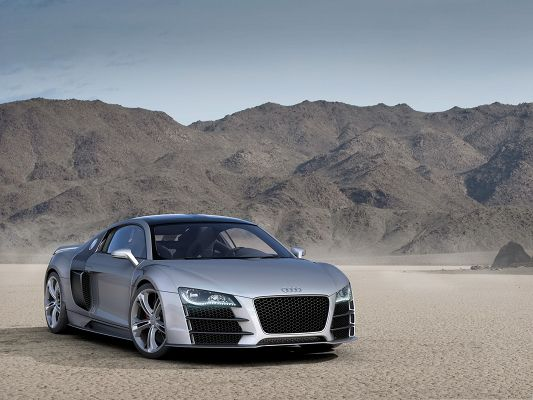click to free download the wallpaper--Audi R8 Car as Background, Silver Super Car Surrounded by Tall Hills