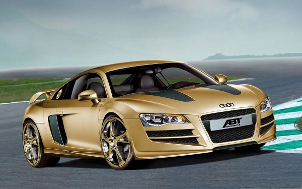 click to free download the wallpaper--Audi R8 Wallpaper, Golden Car Turning a Corner, Under the Blue Sky