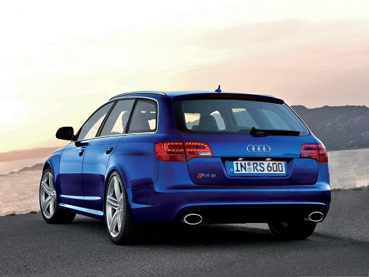 click to free download the wallpaper--Audi RS6 Avant Car, Blue Super Car in Front of the Sea, Wide and Free