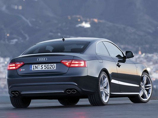 click to free download the wallpaper--Audi S5 Coupe Car as Wallpaper, Gray Super Car Among Tall Hills, Amazing Scene