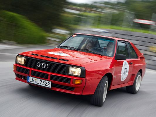 click to free download the wallpaper--Audi Sport Quattro Car, Red Super Car in the Run, About to Turn a Corner