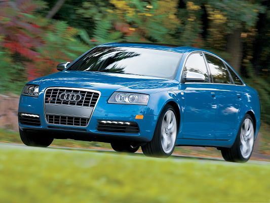 click to free download the wallpaper--Audi Super Cars Image, Blue S6 Sedan Car in Pretty Full Speed, Amazing Scene