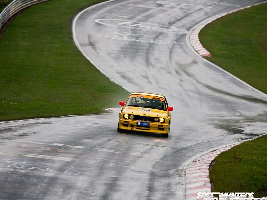 click to free download the wallpaper--BMW Car Wallpaper, Yellow Car in the Run, Crooked Roads