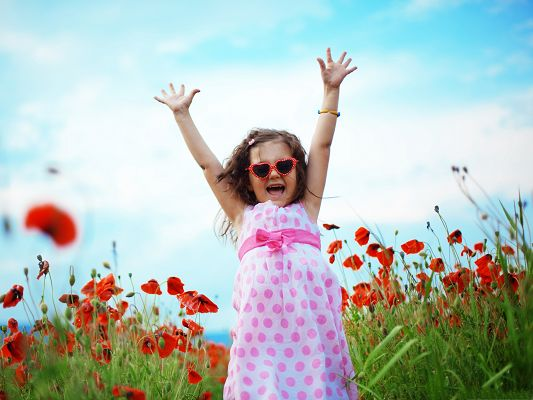 click to free download the wallpaper--Baby Girl Outdoor, Kid in Pink Dress, Surrounded by Red Tulips, Great Mood