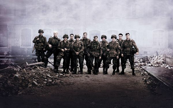 click to free download the wallpaper--Band of Brothers HD Post in 1920x1200 Pixel, All Men Standing Next to an Old Building, All Men Are Brothers - TV & Movies Post