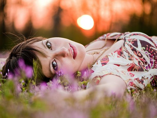 Beautiful Girl Outdoor, Amazing Girl Lying on Grass and Flowers, Snowy White Skin