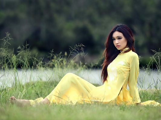 click to free download the wallpaper--Beautiful Girl Outdoor, in Yellow Long Dress, Dancing Hair
