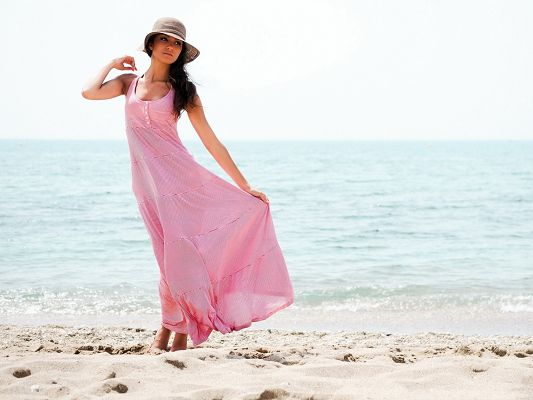 click to free download the wallpaper--Beautiful Girls Picture, Walking on Soft Sand, Pink Long Dress, Comfortable Time
