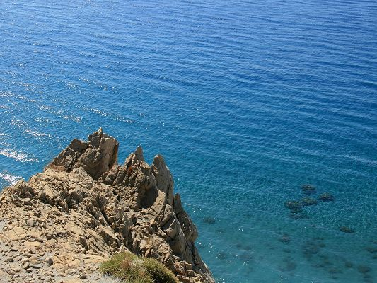 Beautiful Image of Natural Landscape, Rocky Cliff, the Clear Blue Sea, Echoes to be Heard