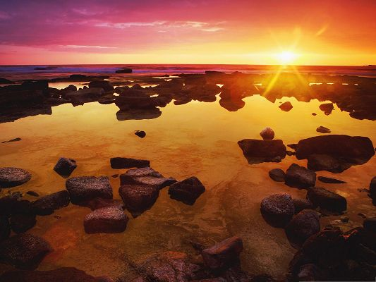 click to free download the wallpaper--Beautiful Nature Landscape, the Rising Sun, Golden Horizon, Big Stones
