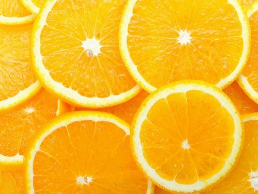 click to free download the wallpaper--Beautiful Pic with Fruits, Thin Orange Slices, Piled Up, Incredible Look