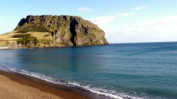 Beautiful Pics of the Sea - The Blue and Clear Sea, a Green Hill in the Middle, Yellow Sand by Beach