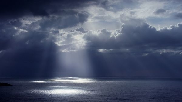 Beautiful Scene of Nature - The Dark and Cloudy Sky, Sunlight Breaking Through, the Peaceful Sea, Great in Look