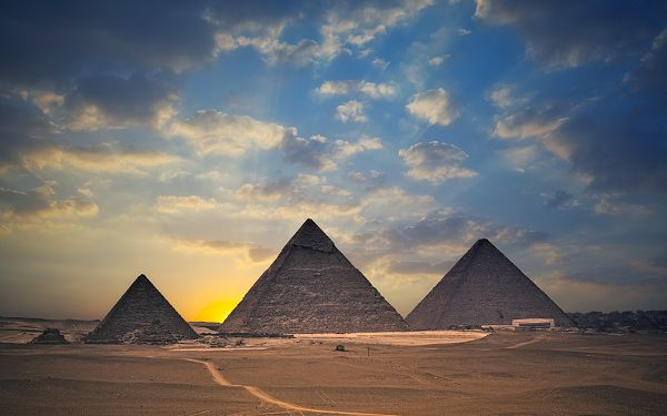 click to free download the wallpaper--Beautiful Sceneries of the World - Egypt Pyramids Are Huge and Majestic, the Rising Sun and Golden Light Make Them Sacred