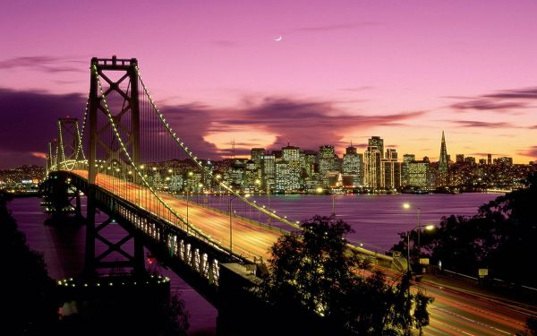 click to free download the wallpaper--Beautiful Sceneries of the World - San Francisco Bridge California, Bridge in All Lights, Tall Buildings Under the Purple Sky, Romantic Scene